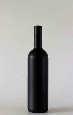 Wine bottle are standing on gray background
