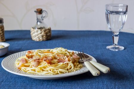 Pasta Carbonara on a blue background. Italian food.