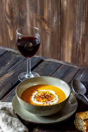 Pumpkin soup on a wooden background. Healthy eating. Diet. Vegetarian food. Autumn. Recipes.