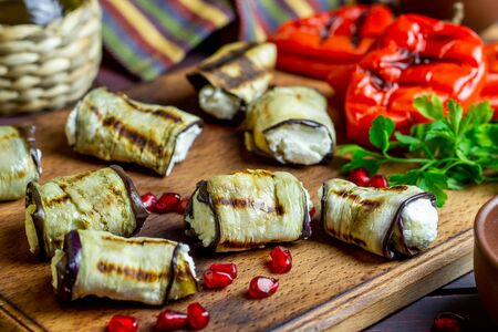 Eggplant rolls with cheese on a wooden background. Healthy eating. Vegetarian food. Diet. Recipes. Rustic.