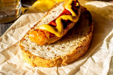 Bread with grilled sausage and mustard. German cuisine. Sandwich. Bbq. Rustic. Stok Fotoğraf