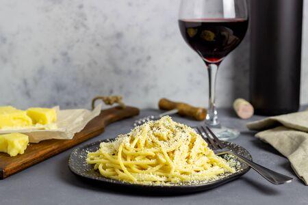 Roman pasta spaghetti with black pepper and cheese. Cacio e pepe. Recipes. Wine. Vegetarian food. National cuisine.