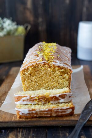Homemade lemon cake on a wooden background. Recipe. Vegetarian food. Pastries