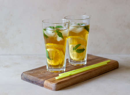 Cold tea with lemon and mint. A summer drink. Healthy eating. Vegetarian food. Diet