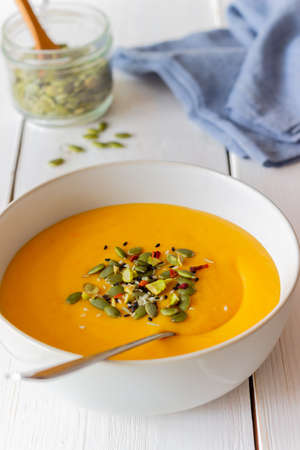 Pumpkin cream soup with seeds, pistachios, sesame seeds and spices. Healthy eating. Vegetarian food.