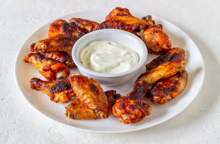 Barbecue chicken wings on a white background. Grill. Recipe. 免版税图像