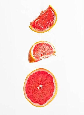 Grapefruit sliced isolated on the white background. Vertical orientation.
