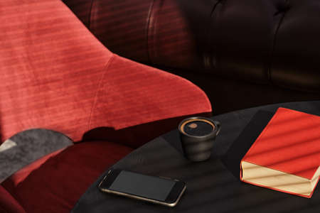 Cup of espresso on a black table, a red book and a red armchair, bright sunbeams on the table. Interior details of a cafe or loft studio