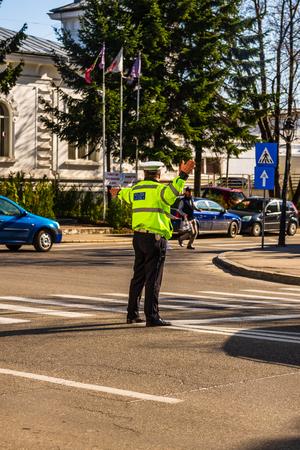 Targoviste, Romania - Police officer directing traffic in downtown junction in Targoviste city. Stock Photo
