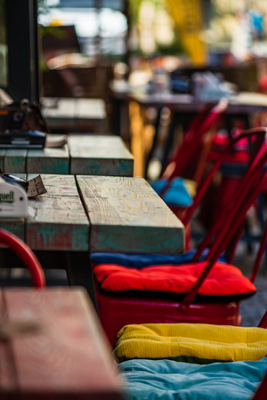 Bucharest, Romania - 2019. Colorful wooden tables on the narrow street of Bucharest Old Town.