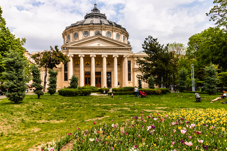 Bucharest, Romania - 2019. People in front of the Romanian Athenaeum in the center of Bucharest, a landmark of the Romanian capital city.
