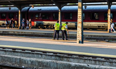 Bucharest, Romania - 2019. Railway workers check the condition of the track. Redactioneel