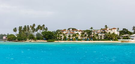 Idyllic beach in Barbados Island, Caribbean. Beach line, white sand, clear turquoise water.