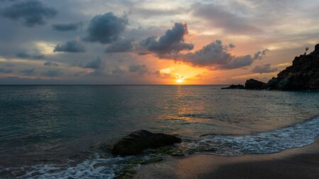 Travel photo of St. Barth's Island (St. Bart's Island), Caribbean. View of a peaceful sunset and waves on Shell Beach. Stock Photo