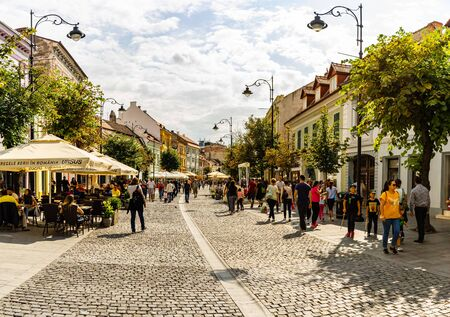 Sibiu, Romania - 2019. People and tourists having lunch and wandering on the streets of Sibiu old town. Editorial