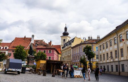 Sibiu, Romania - 2019. People wandering on the streets of Sibiu (old town). Streets with colorful houses. Editorial