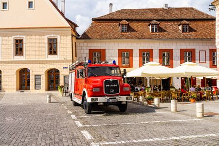 Sibiu, Romania - 2019. Old vintage firefighting car parked on the antient streets of Sibiu.