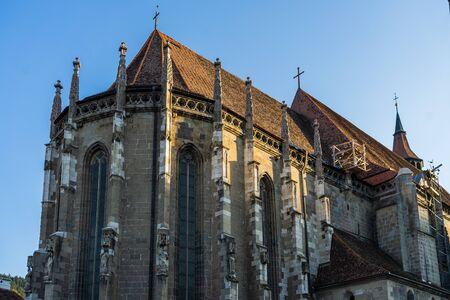 Façade of a medieval church. The Black Church ( Biserica Neagra) in Brasov, Romania. Banco de Imagens