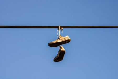 Shoes hanging from a wire in Bucharest Stok Fotoğraf