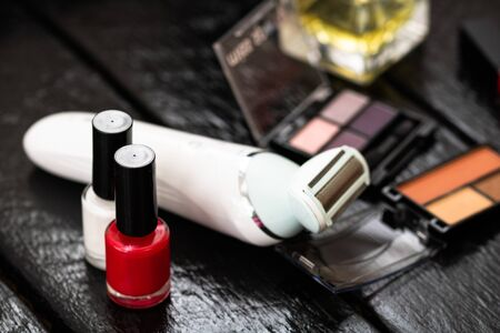 Various cosmetics on a black background. Beauty products, close up photo.Various cosmetics on a black background. Beauty products, close up photo. Stock Photo