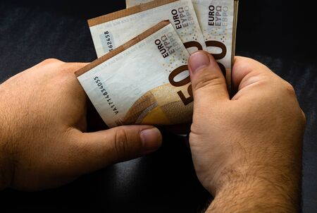 Man counting money, counting EURO close up