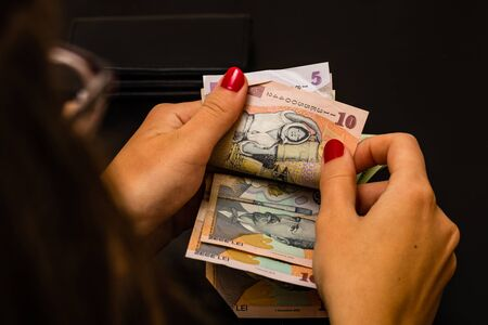 Woman counting money, counting LEI close up