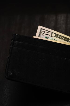 Man wallet with money on the table, wallet with dollars Foto de archivo