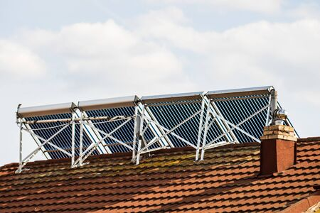 Photo of solar water heaters on roof top. Stockfoto