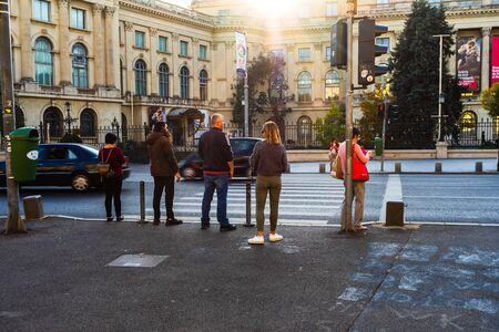 Pedestrians waiting to cross the street in Bucharest, Romania, 2019 Redakční