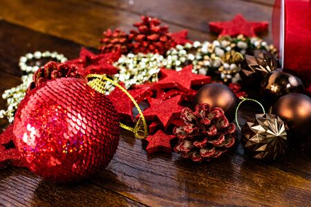 Christmas decorations on wooden board. Colorful, gliterry and shiny Christmas decorations.