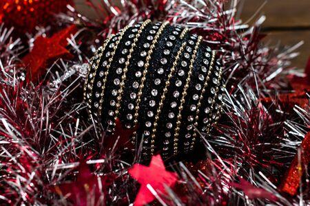 Christmas decorations on wooden board. Christmas concept. Black and shiny Christmas ball.