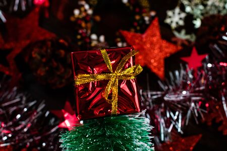 Small gift box. Christmas decorations against blurred background.
