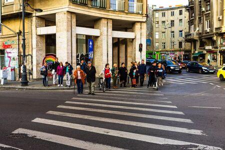 Pedestrians crossing in street in the morning, Bucharest, Romania, 2019 Redakční