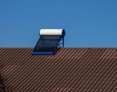 Solar water heater on roof top. Solar panel for hot water, system on roof.