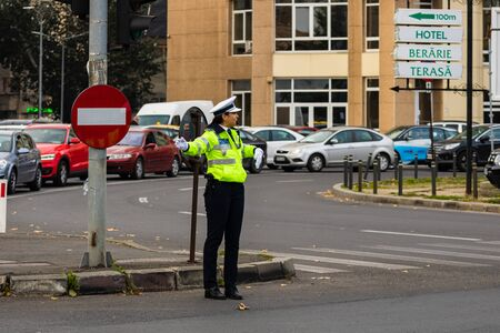 Police agent directing traffic during the morning rush hour in downtown Bucharest, Romania, 2019 에디토리얼