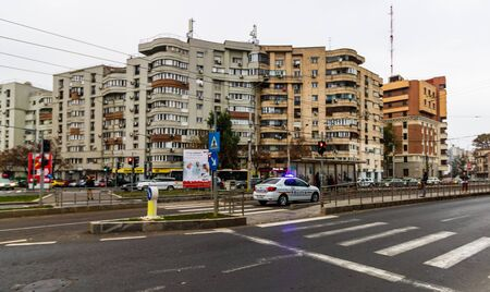 Police car in mission with the lights on in Bucharest, Romania, 2019 에디토리얼