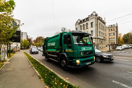 Garbage truck in the morning traffic on the streets of Bucharest, Romania, 2019