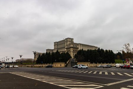 Traffic on the main boulevard in downtown Bucharest. Parliament Palace early in the morning in Bucharest, Romania, 2019
