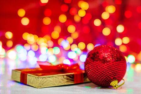 Christmas decorations and ornaments. Christmas composition on blurred lights background