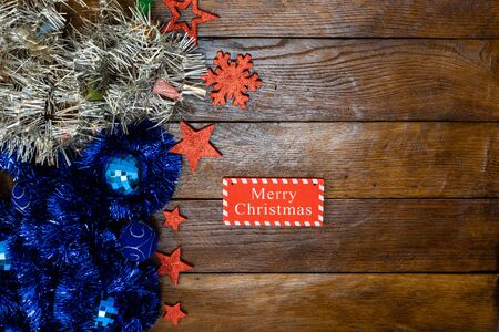 Colorful Christmas garlands. Christmas composition on wooden board with Christmas garland and decorations. Banco de Imagens