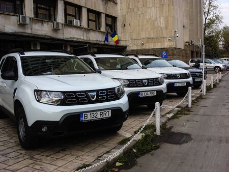 White Dacia Duster cars parked in line on street in Bucharest, Romania, 2019. Redactioneel