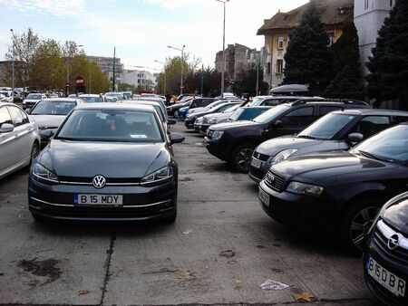 Cars parked in the parking lot. Bucharest, Romania, 2019. Stok Fotoğraf - 134758296