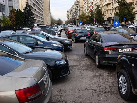 Cars parked in the parking lot. Bucharest, Romania, 2019. Stok Fotoğraf - 134758297