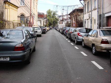 Cars parked along the street. Bucharest, Romania, 2019. Stok Fotoğraf - 134758300