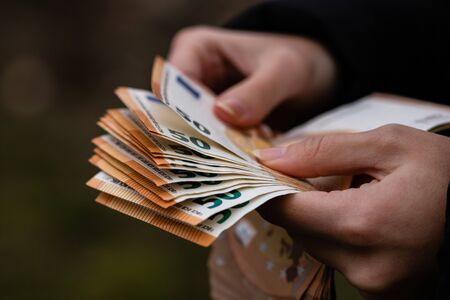 Woman counting money, counting EURO close up