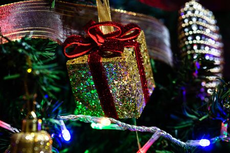 Christmas hanging decorations on fir tree. Decorated Christmas tree.  Fir branches with Christmas decorations. Stok Fotoğraf - 134768594
