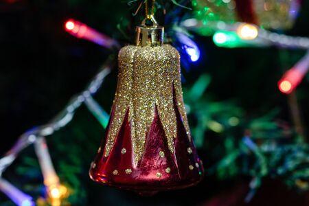Christmas hanging decorations on fir tree. Decorated Christmas tree.  Fir branches with Christmas bell.