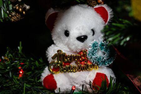 Christmas hanging decorations on fir tree. Decorated Christmas tree.  Fir branches with Christmas decorations. Christmas bear,