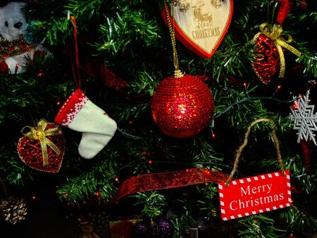 Christmas hanging decorations. Decorated Christmas tree with balls, garlands and lights. Fir branches with Christmas decorations. Stok Fotoğraf - 134769324
