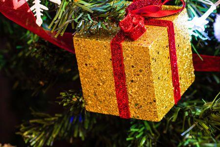 Christmas hanging decorations on fir tree. Decorated Christmas tree. Fir branch with gift decoration Stok Fotoğraf - 134769025